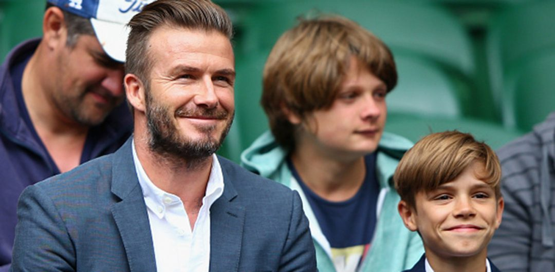 LONDON, ENGLAND - JULY 08:  David Beckham and son Romeo Beckham attend day nine of the Wimbledon Lawn Tennis Championships at the All England Lawn Tennis and Croquet Club on July 8, 2015 in London, England.  (Photo by Ian Walton/Getty Images)